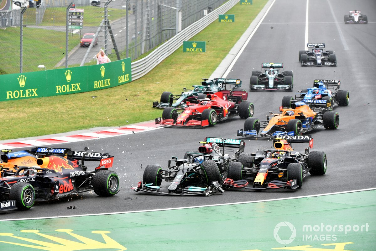 Valtteri Bottas, Mercedes W12, collides with Sergio Perez, Red Bull Racing RB16B, at the start