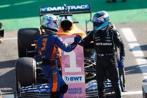 Daniel Ricciardo, McLaren, 1st position, and Valtteri Bottas, Mercedes, 3rd position, congratulate each other in Parc Ferme