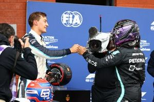 George Russell, Williams, and Lewis Hamilton, Mercedes, congratulate each other in Parc Ferme after Qualifying