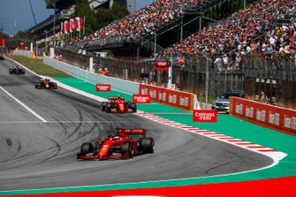 Sebastian Vettel, Ferrari SF90, leads Charles Leclerc, Ferrari SF90, and Pierre Gasly, Red Bull Racing RB15