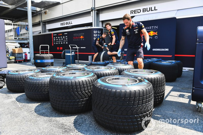 Red Bull Racing mechanics with Pirelli tyres