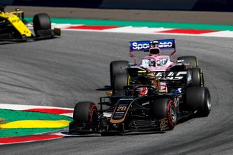 Kevin Magnussen, Haas F1 Team VF-19 leads Sergio Perez, Racing Point RP19 and Nico Hulkenberg, Renault F1 Team R.S. 19