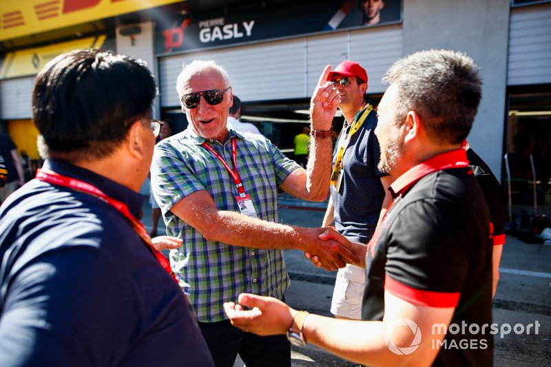 Dietrich Mateschitz, Co-Founder and CEO, Red Bull GmbH and Masashi Yamamoto, General Manager, Honda Motorsport celebrate the race victory