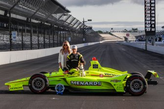 Simon Pagenaud, Team Penske Chevrolet, girlfriend Hailey McDermott and dog Norman pose for front row photos