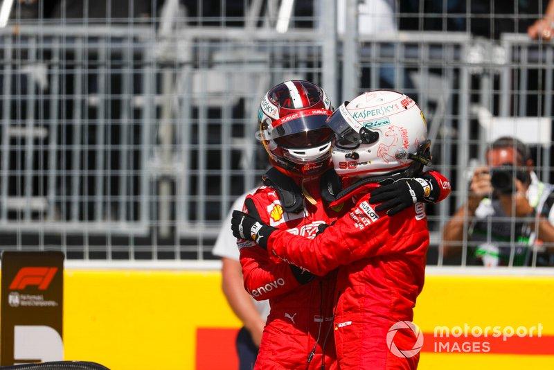Charles Leclerc, Ferrari, congratulates his team mate, Sebastian Vettel, Ferrari, on pole position