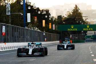 Lewis Hamilton, Mercedes AMG F1 W10 and Polesitter Valtteri Bottas, Mercedes AMG W10 Drives into Parc Ferme