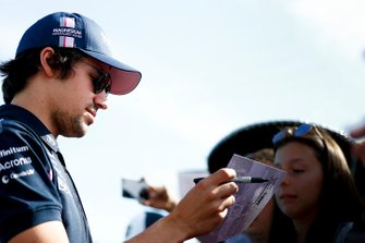 Lance Stroll, Racing Point signs a autograph for a fan