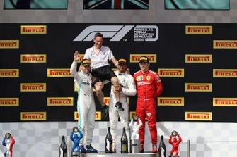 Valtteri Bottas, Mercedes AMG F1, 2nd position, Nathan Divey, No.1 Mechanic (Hamilton), Mercedes AMG, Lewis Hamilton, Mercedes AMG F1, 1st position, and Charles Leclerc, Ferrari, 3rd position, on the podium
