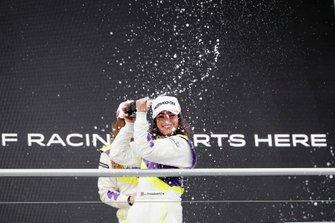 Jamie Chadwick sprays the champagne on the podium