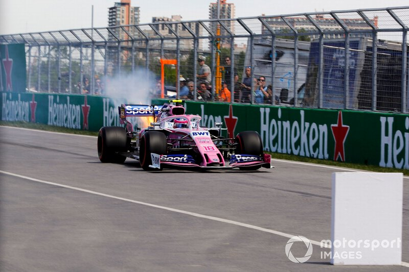 Car of Lance Stroll, Racing Point RP19 enters the pit lane with fire coming out