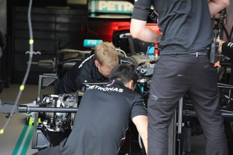 Crew members at work in Mercedes garage