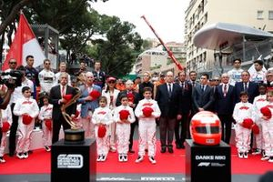 Chase Carey, Chairman, Formula 1, Princess Charlene, Prince Albert II, Jean Todt, President, FIA and his wife Michelle Yeoh, and the grid kid Mascots gathered to pay tribute to the late Niki Lauda