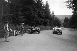 Raymond Sommer, Jean Delemer, Chrysler, passes the abandoned Rally of Antoine, Antony, #30 and Lancia of Hertzberger, Guillaume