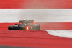 Sparks and smoke in the wake of Lewis Hamilton, Mercedes F1 W11 EQ Performance