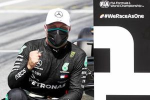 Valtteri Bottas, Mercedes-AMG Petronas F1, celebrates after securing pole position