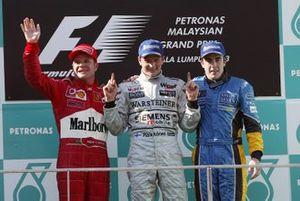 Podium: race winner Kimi Raikkonen, McLaren, second place Rubens Barrichello, Ferrari, third place Fernando Alonso, Renault