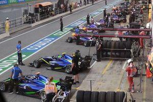 F3 Cars In The Pit Lane, Including Cameron Das, Carlin Buzz Racing And Leonardo Pulcini, Carlin Buzz Racing