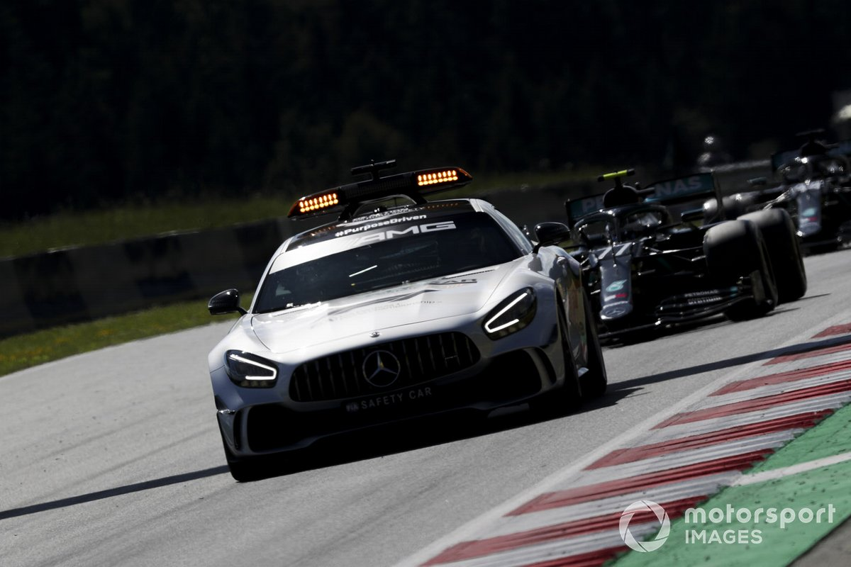 The Safety Car leads Valtteri Bottas, Mercedes F1 W11 EQ Performance