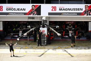 Romain Grosjean, Haas VF-20, and Kevin Magnussen, Haas VF-20, in the garage
