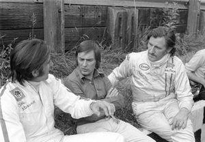 Carlos Reutemann, Brabham Team Boss Bernie Ecclestone and Graham Hill