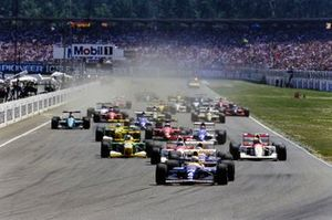 Riccardo Patrese, Williams FW14B Renault, leads at the start of the race