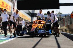 Car of Lando Norris, McLaren MCL35 being pushed down the pit lane