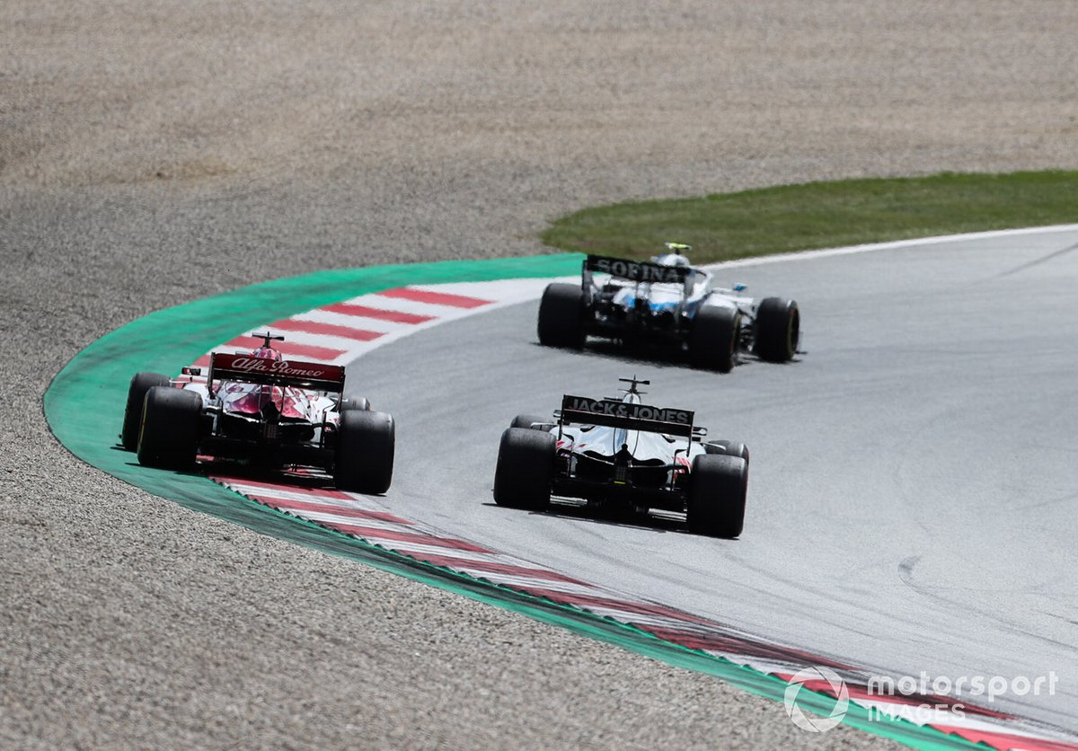 Nicholas Latifi, Williams FW43, leads Romain Grosjean, Haas VF-20, and Kimi Raikkonen, Alfa Romeo Racing C39