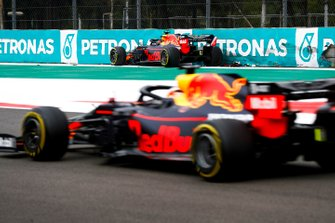 Alex Albon, Red Bull RB15 crashes in FP2 as Max Verstappen, Red Bull Racing RB15 drives past