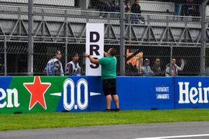 Michael Masi, Race Director, FIA, assists with the installation of DRS zone marker sign