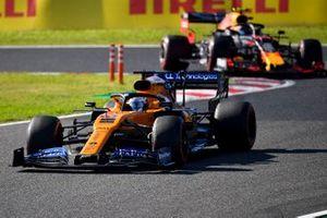 Carlos Sainz Jr., McLaren MCL34, leads Alex Albon, Red Bull RB15
