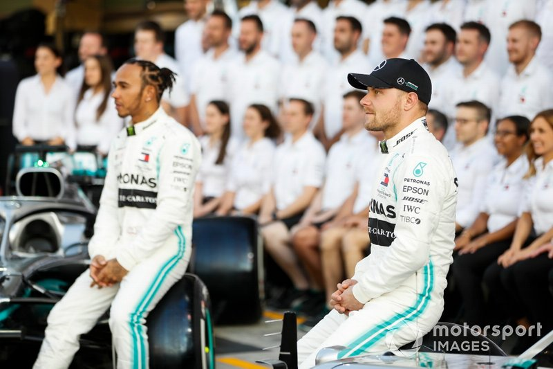 Lewis Hamilton, Mercedes AMG F1, poses for a group photo alongside Valtteri Bottas, Mercedes AMG F1