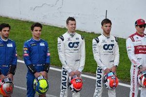 Carlos Sainz, McLaren, Lando Norris, McLaren, Daniil Kvyat, AlphaTauri, Pierre Gasly, AlphaTauri and Kimi Raikkonen, Alfa Romeo line up on the track