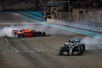 Max Verstappen, Red Bull Racing RB15, and Lewis Hamilton, Mercedes AMG F1 W10, perform donuts