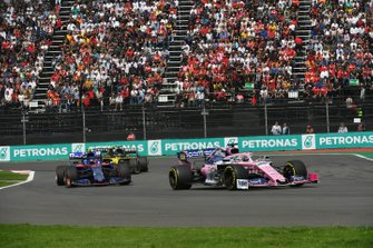 Sergio Perez, Racing Point RP19, leads Pierre Gasly, Toro Rosso STR14, and Daniel Ricciardo, Renault R.S.19