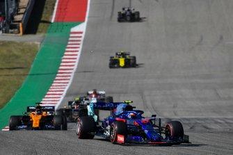 Pierre Gasly, Toro Rosso STR14, leads Carlos Sainz Jr., McLaren MCL34, Kevin Magnussen, Haas F1 Team VF-19, Kimi Raikkonen, Alfa Romeo Racing C38, and Nico Hulkenberg, Renault F1 Team R.S. 19