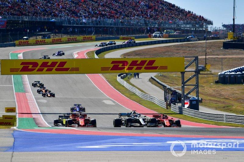 Lewis Hamilton, Mercedes AMG F1 W10, leads Charles Leclerc, Ferrari SF90 and Sebastian Vettel, Ferrari SF90