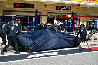 The car of Romain Grosjean, Haas F1 Team VF-19 is returned to the pit lane