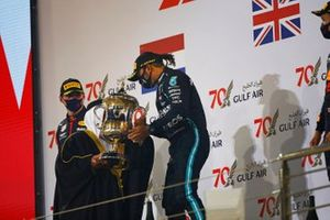 Lewis Hamilton, Mercedes-AMG F1, 1st position, receives his trophy