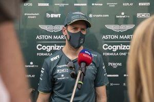 Sebastian Vettel, Aston Martin AMR21, talks to the media
