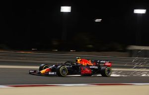 Sergio Perez, Red Bull Racing RB16B, kicks up some sparks