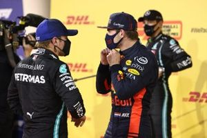 Pole man Valtteri Bottas, Mercedes-AMG F1, and Max Verstappen, Red Bull Racing, talk in Parc Ferme after Qualifying