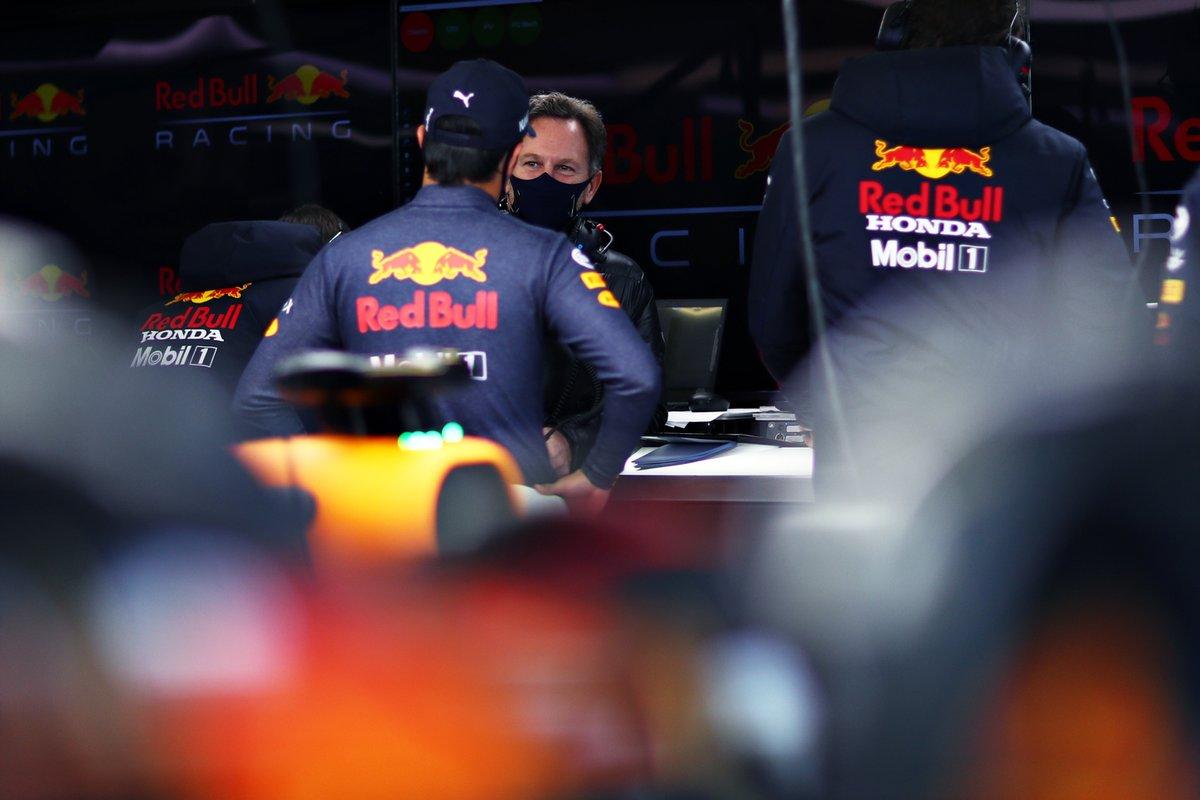 Sergio Perez, Red Bull Racing talks to the Team Principal Christian Horner