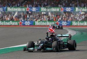 Lewis Hamilton, Mercedes W12, 1st position, flies a Union flag from his cockpit on his way to Parc Ferme