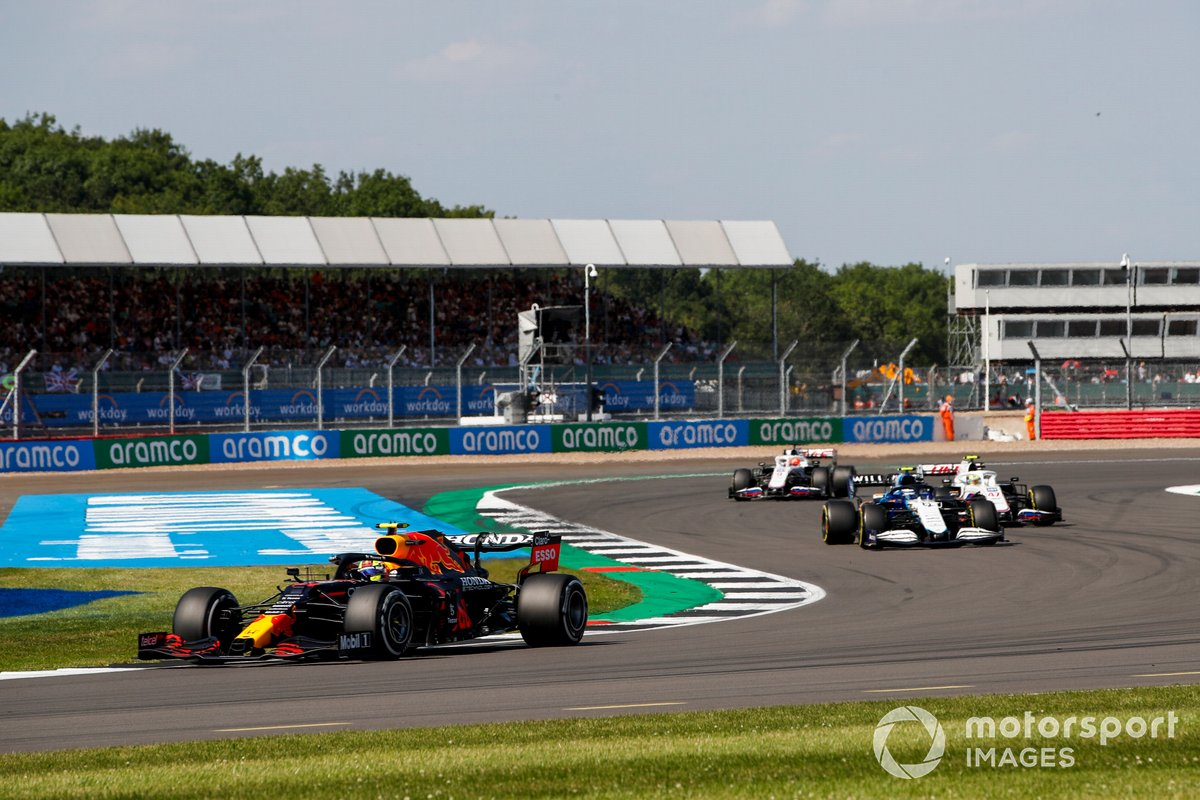 Sergio Perez, Red Bull Racing RB16B, Nicholas Latifi, Williams FW43B, and Mick Schumacher, Haas VF-21