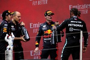Sergio Perez, Red Bull Racing, 3rd position, Gianpiero Lambiase, Race Engineer, Red Bull Racing, Max Verstappen, Red Bull Racing, 1st position, and Lewis Hamilton, Mercedes, 2nd position, celebrate on the podium