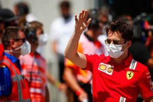 Charles Leclerc, Ferrari waves at fans from the drivers parade lorry