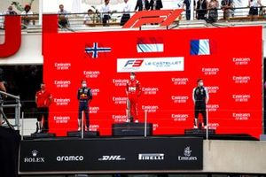 Dennis Hauger, Prema Racing, 2nd position, Arthur Leclerc, Prema Racing, 1st position, and Victor Martins, MP Motorsport, 3rd position, on the podium