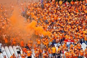 Dutch fans turn the venue orange after a win for Max Verstappen, Red Bull Racing, 1st position