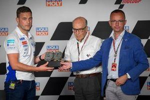 FIM board member Jan Stovicek and Dorna Sports CEO Carmelo Ezpeleta present the trophy to Florian Prüstel