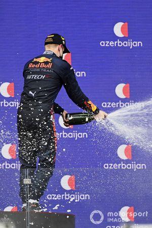 Juri Vips, Hitech Grand Prix, 1st position, sprays champagne on the podium